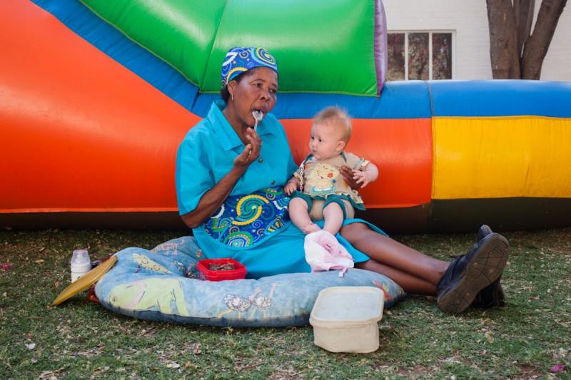 "Domestic helper taking care of her emloyers child, Thabazimbi. Photograph by Sipho Mpongo from the ""Twenty Journey Project"" - www.twentyjourney.com"