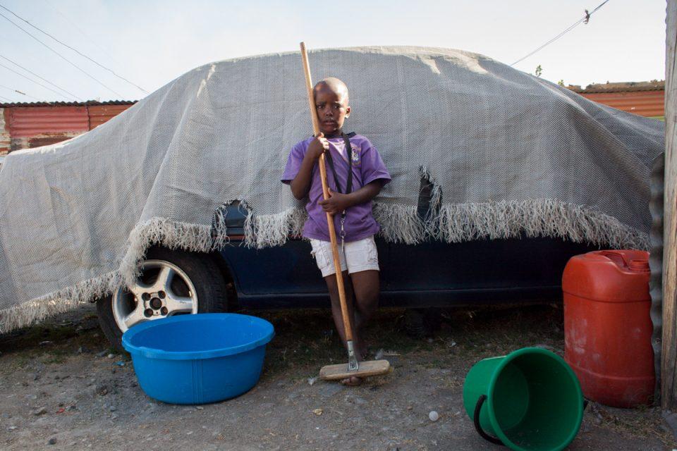 """Zameka Nungu allowed me to speak with her three children: Nowili Nungu (16), Luxolo Nungu (6) and Xolile Nungu (13). Photograph by Sipho Mpongo from the """"Twenty Journey Project"""" - www.twentyjourney.com"""