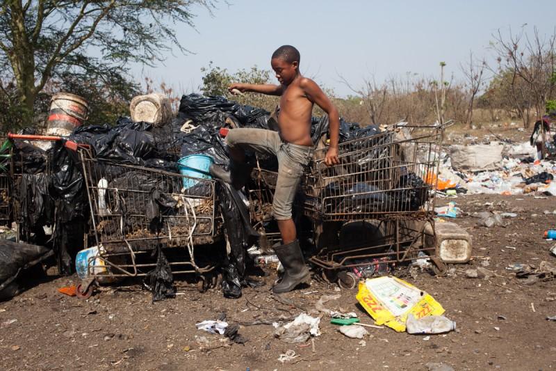 "Boy searching for scraps, Kwaloliwe. Photograph by Sipho Mpongo from the ""Twenty Journey Project"" - www.twentyjourney.com"